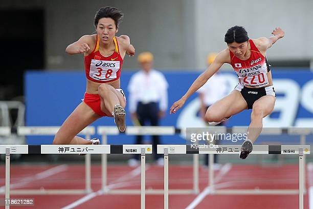 Satomi Kubokura of Japan competes with Yang Qi of China in the Women's 400m Hurdles final during the day three of the 19th Asian Athletics...