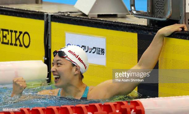 Satomi Suzuki celebrates winning the gold medal after competing in the Women's 50m final during day two of the Japan Swim at Nippon Gaishi Areana on...