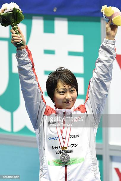 Satomi Suzuki of Japan celebrates on the podium after winning the silver medal for women 100m Breaststroke during day one of the Japan Open 2014 at...