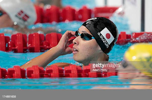 Satomi Suzuki of Japan competes during the Swimming Women's 100m Breaststroke preliminaries heat six on day ten of the 15th FINA World Championships...