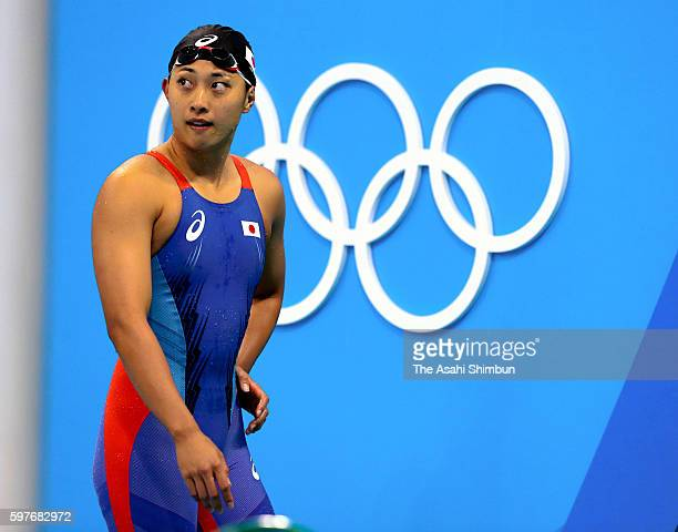 Satomi Suzuki of Japan reacts after competing in the Women's 100m Breaststroke semifinal on Day 2 of the Rio 2016 Olympic Games at the Olympic...