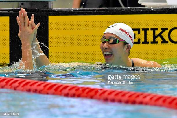Satomi Suzuki reacts after setting the new Japan record after competing in the Women's 50m Breaststroke qualification on day one of the Japan Swim...