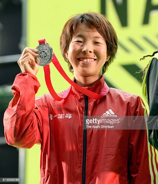 Satomi Tanaka of Japan celebrates finishing second and top of Japanese runners in the Nagoya Women's Marathon at the Nagoya Dome on March 13 2016 in...