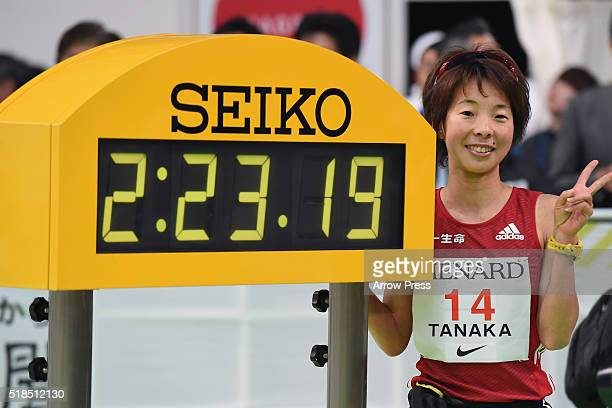 Satomi Tanaka of Japan poses with her time after finishing second in the Nagoya Women's Marathon 2016 on March 13 2016 in Nagoya Japan