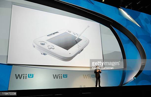 Satoru Iwata Global President Nintendo Co Ltd speaks during a news conference after the unveiling of the new game console Wii U at the Electronic...