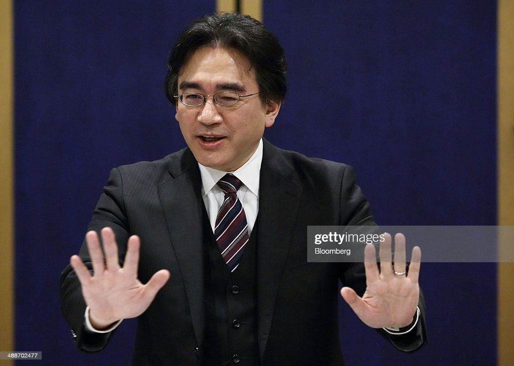 Satoru Iwata, president of Nintendo Co., gestures as he speaks during an interview in Tokyo, Japan, on Thursday, May 8, 2014. Nintendo, the Japanese maker of video-game machines struggling to win over consumers with its latest generation of devices, plans to expand in emerging markets with new gaming devices starting next year. Photographer: Tomohiro Ohsumi/Bloomberg via Getty Images