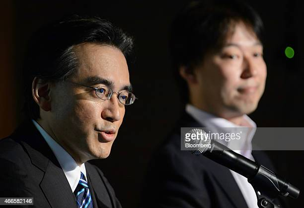 Satoru Iwata president of Nintendo Co left speaks while Isao Moriyasu president and chief executive officer of DeNA Co listens during a joint news...