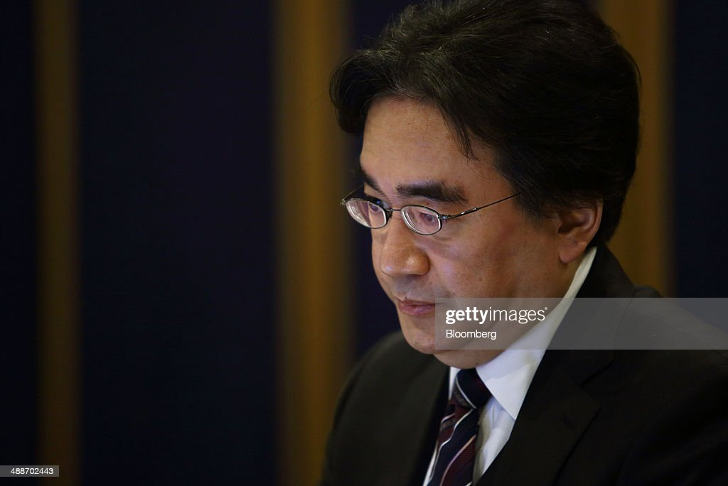Satoru Iwata, president of Nintendo Co., pauses during an interview in Tokyo, Japan, on Thursday, May 8, 2014. Nintendo, the Japanese maker of video-game machines struggling to win over consumers with its latest generation of devices, plans to expand in emerging markets with new gaming devices starting next year. Photographer: Tomohiro Ohsumi/Bloomberg via Getty Images