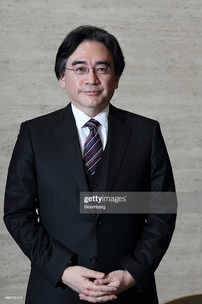 Satoru Iwata, president of Nintendo Co., poses for a photograph after an interview in Tokyo, Japan, on Thursday, May 8, 2014. Nintendo, the Japanese maker of video-game machines struggling to win over consumers with its latest generation of devices, plans to expand in emerging markets with new gaming devices starting next year. Photographer: Tomohiro Ohsumi/Bloomberg via Getty Images