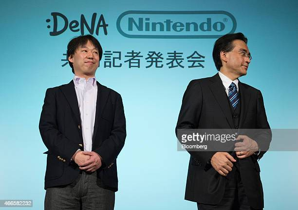 Satoru Iwata president of Nintendo Co right and Isao Moriyasu president and chief executive officer of DeNA Co attend a joint news conference in...