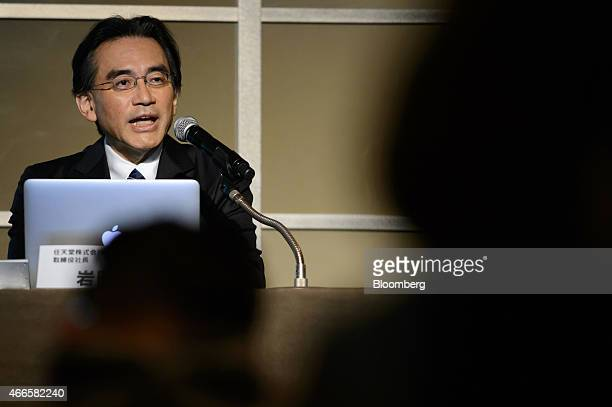 Satoru Iwata president of Nintendo Co speaks during a joint news conference with Isao Moriyasu president and chief executive officer of DeNA Co...