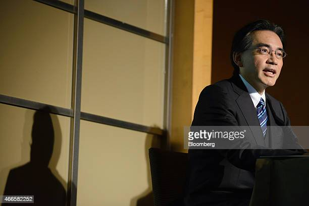 Satoru Iwata president of Nintendo Co speaks during a joint news conference with Isao Moriyasu president and chief executive officer of DeNA Co in...