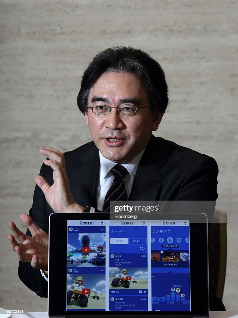 Satoru Iwata, president of Nintendo Co., speaks during an interview in Tokyo, Japan, on Thursday, May 8, 2014. Nintendo, the Japanese maker of video-game machines struggling to win over consumers with its latest generation of devices, plans to expand in emerging markets with new gaming devices starting next year. Photographer: Tomohiro Ohsumi/Bloomberg via Getty Images