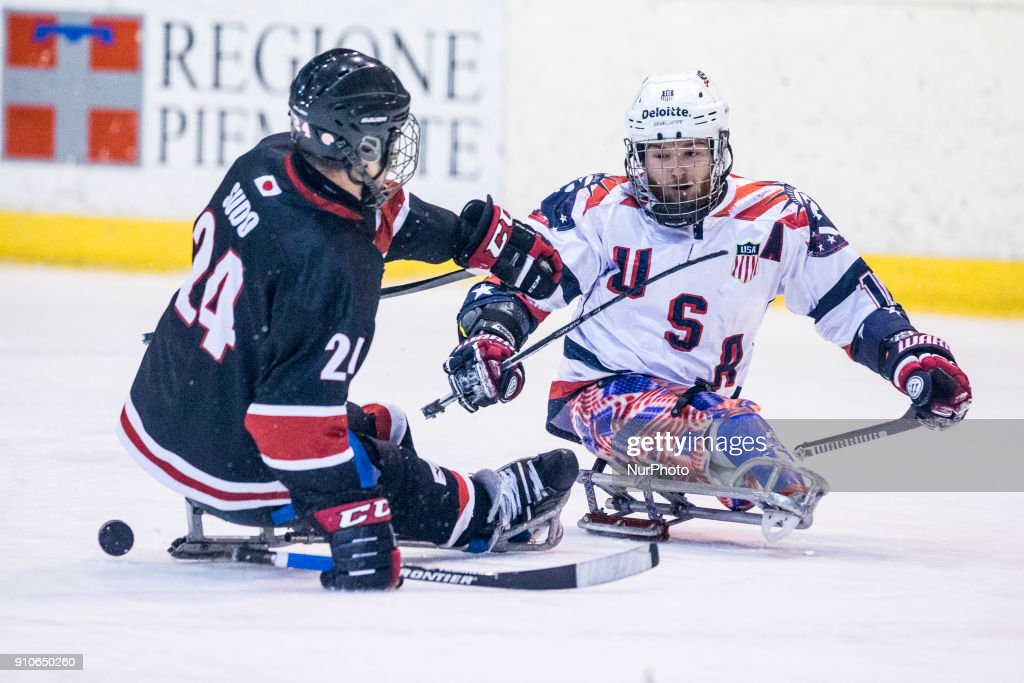 Satoru Sudo (Japan) and Declan Farmer (USA) during International Para Ice Hockey Tournament of Torino Semifinal match between USA and Japan in Turin, italy, on 26 Januray 2018. Usa team won 9 - 0. This is the last tournament before the Paralympic Games of Pyeongchang 2018 in Korea.