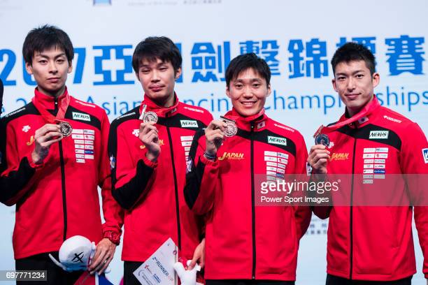 Satoru Uyama Masaru Yamada Inochi Ito and Kazuyasu Minobe of Japan pose for photos with their bronze medals during the Asian Fencing Championships...