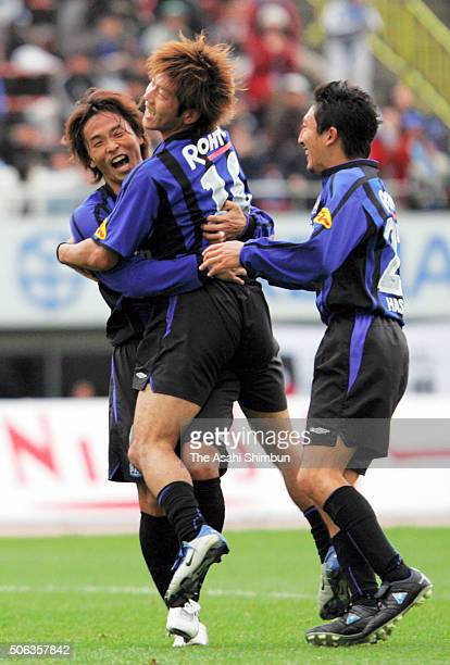 Satoru Yamaguchi of Gamba Osaka celebrates scoring his team's third goal with his team mates Masashi Oguro and Hideo Hashimoto during the JLeague...