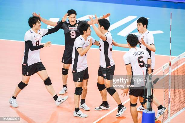 Satoshi Ide and team of Japan celebrates during the Nations League match between Iran and Japan at Kindarena Stadium on May 27, 2018 in Rouen, France.