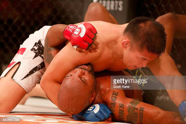 Satoshi Ishii of Japan grapples with Quinton Rampage Jackson of the United States during the main event bout at Bellator 157 inside the Scottrade...