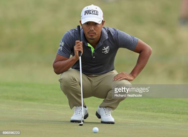 Satoshi Kodaira of Japan lines up a putt on the ninth green during the second round of the 2017 US Open at Erin Hills on June 16 2017 in Hartford...