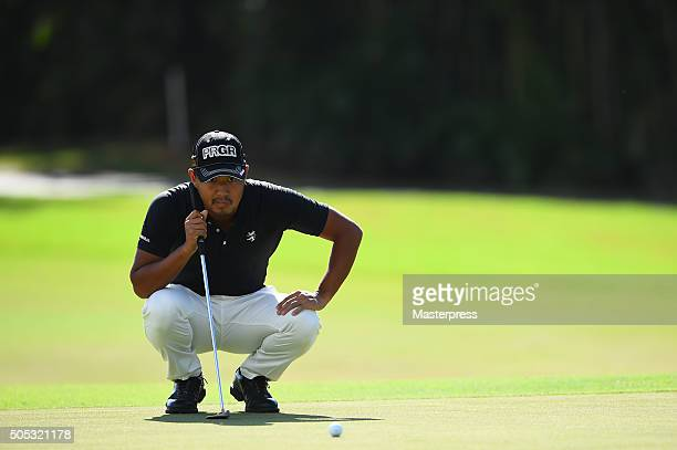 Satoshi Kodaira of Japan lines up on the 2nd green during the third round of the Sony Open In Hawaii at Waialae Country Club on January 16 2016 in...
