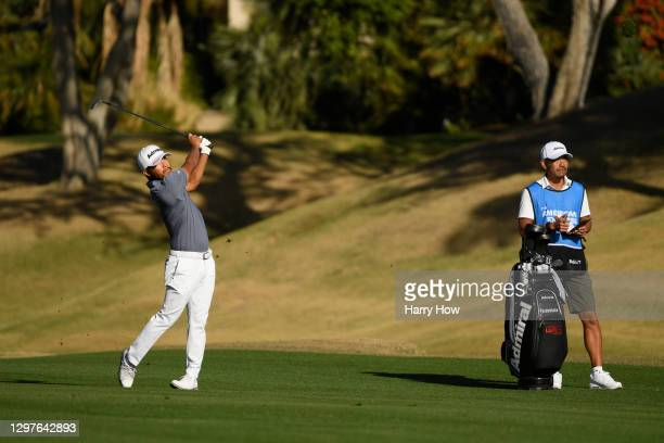 Satoshi Kodaira of Japan plays a shot on the 10th fairway during the first round of The American Express tournament on the Jack Nicklaus Tournament...