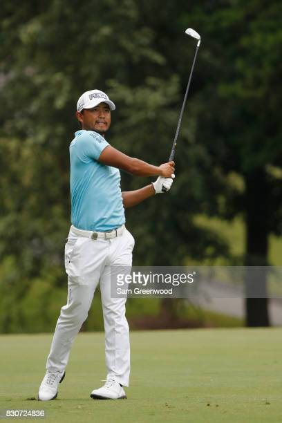 Satoshi Kodaira of Japan plays his second shot on the third hole during the third round of the 2017 PGA Championship at Quail Hollow Club on August...