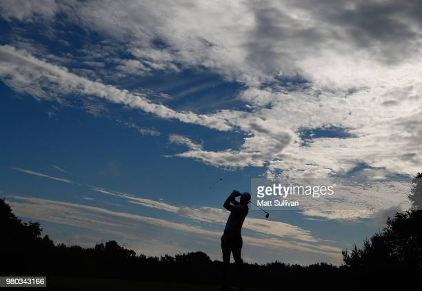 Satoshi Kodaira of Japan plays his shot from the 11th tee during the first round of the Travelers Championship at TPC River Highlands on June 21,...
