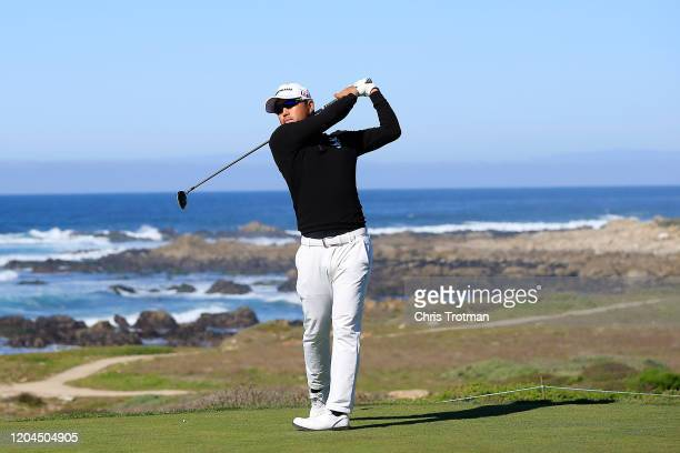 Satoshi Kodaira of Japan plays his shot from the 13th tee during the first round of the AT&T Pebble Beach Pro-Am at Monterey Peninsula Country Club...