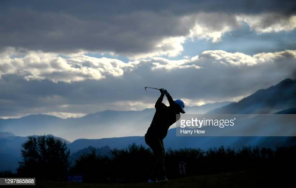 Satoshi Kodaira of Japan plays his shot from the 17th tee during the second round of The American Express tournament on the Stadium course at PGA...