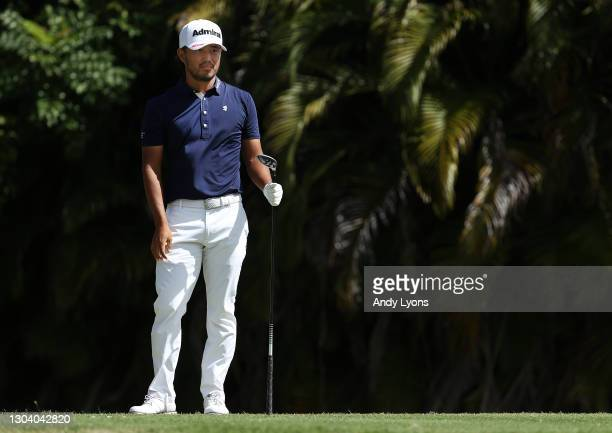 Satoshi Kodaira of Japan plays his shot from the fourth tee during the first round of the Puerto Rico Open at Grand Reserve Country Club on February...