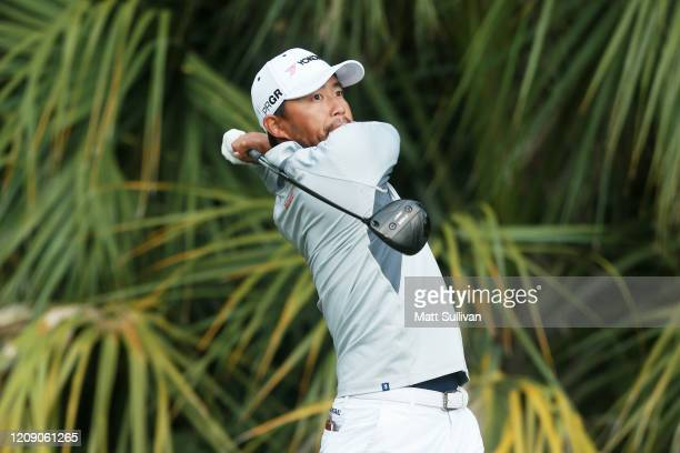 Satoshi Kodaira of Japan plays his shot from the third tee during the first round of the Honda Classic at PGA National Resort and Spa Champion course...