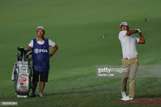 Satoshi Kodaira of Japan plays his shot on the 12th hole during the second round of the 2017 PGA Championship at Quail Hollow Club on August 11 2017...