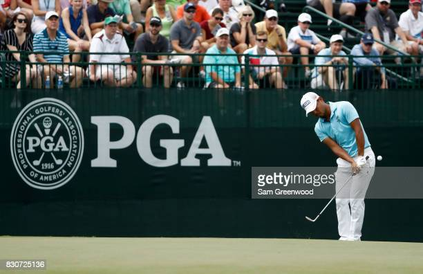 Satoshi Kodaira of Japan plays his shot on the fourth hole during the third round of the 2017 PGA Championship at Quail Hollow Club on August 12 2017...