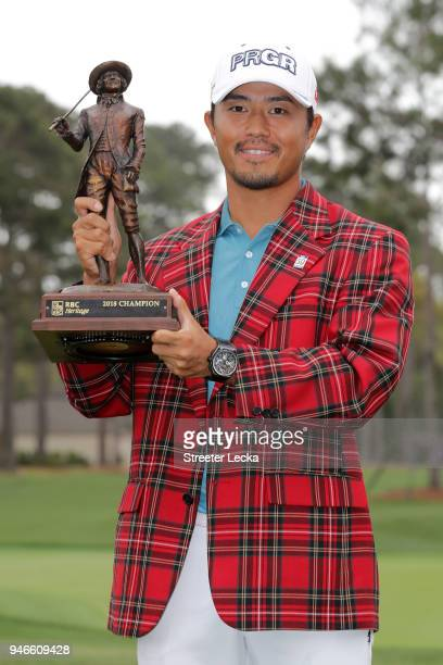 Satoshi Kodaira of Japan poses with the trophy after winning on the third playoff hole during the final round of the 2018 RBC Heritage at Harbour...