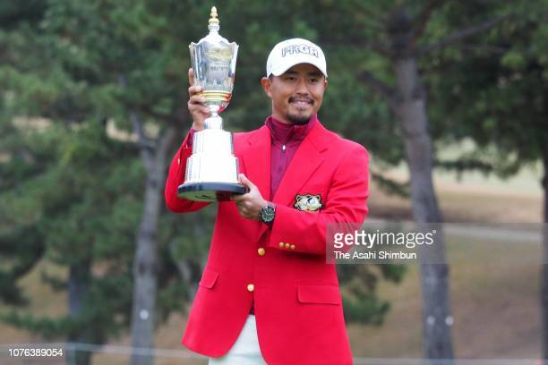 Satoshi Kodaira of Japan poses with the trophy after winning the Golf Nippon Series JT Cup at Tokyo Yomiuri Country Club on December 02, 2018 in...