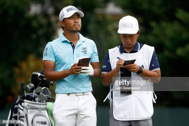 Satoshi Kodaira of Japan prepares to hit off the fourth tee with caddie Ryo Mikami during the third round of the 2017 PGA Championship at Quail...
