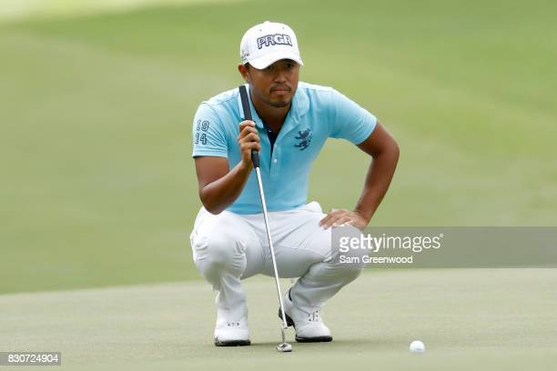 Satoshi Kodaira of Japan putts on the third green during the third round of the 2017 PGA Championship at Quail Hollow Club on August 12 2017 in...