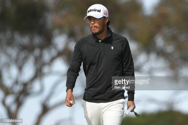Satoshi Kodaira of Japan walks on the 17th green south course during the first round of the Farmers Insurance Open at Torrey Pines South on January...