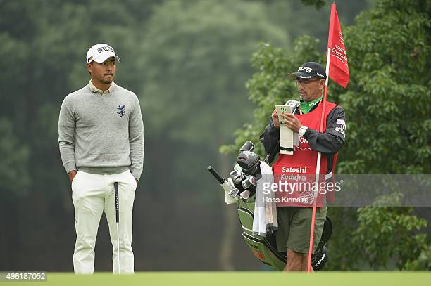 Satoshi Kodaira of Japan with his caddie during the final round of the WGC HSBC Champions at the Sheshan International Golf Club on November 8 2015...