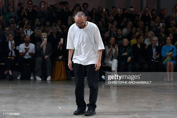 TOPSHOT Satoshi Kondo takes a bows following the Issey Miyake Women's SpringSummer 2020 ReadytoWear collection fashion show in Paris on September 27...