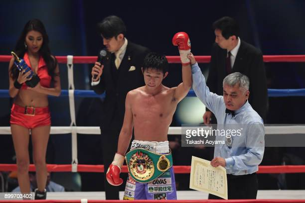 Satoshi Shimizu of Japan celebrates after defeating Eduardo Mancito of Philippines in their OPBF Featherweight Title Bout at the Yokohama Cultural...