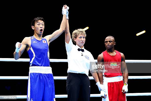 Satoshi Shimizu of Japan celebrates victory over Isaac Dogboe of Ghana during their Men's Bantam Weight bout on Day 1 of the London 2012 Olympic...