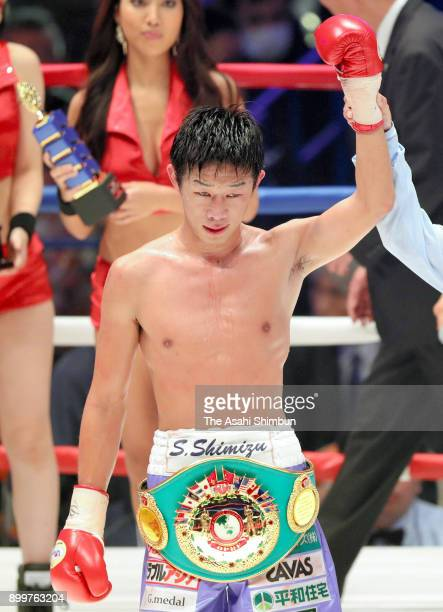 Satoshi Shimizu of Japan celebrates winning over Eduardo Mancito of Philippines in their OPBF Featherweight Title Bout at the Yokohama Cultural...