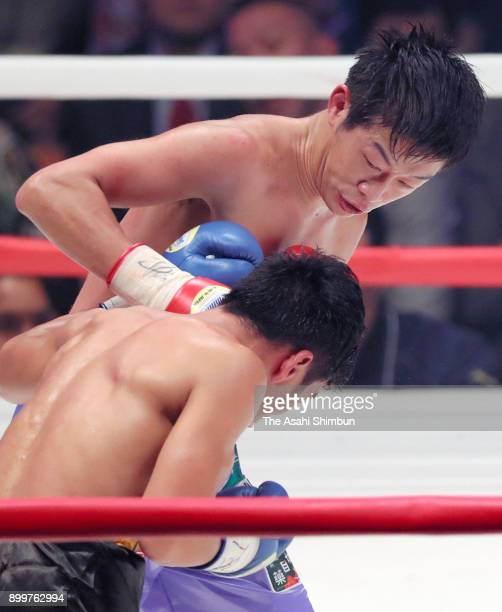 Satoshi Shimizu of Japan connects his right on Eduardo Mancito of Philippines in the 5th round during their OPBF Featherweight Title Bout at the...