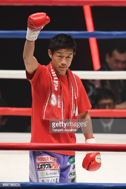 Satoshi Shimizu of Japan enters the ring against Eduardo Mancito of Philippines during their OPBF Featherweight Title Bout at the Yokohama Cultural...
