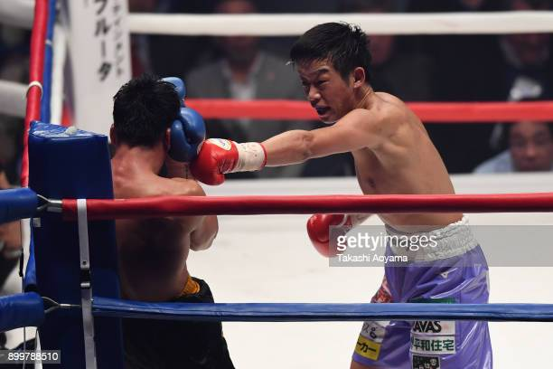 Satoshi Shimizu of Japan punches Eduardo Mancito of Philippines during their OPBF Featherweight Title Bout at the Yokohama Cultural Gymnasium on...