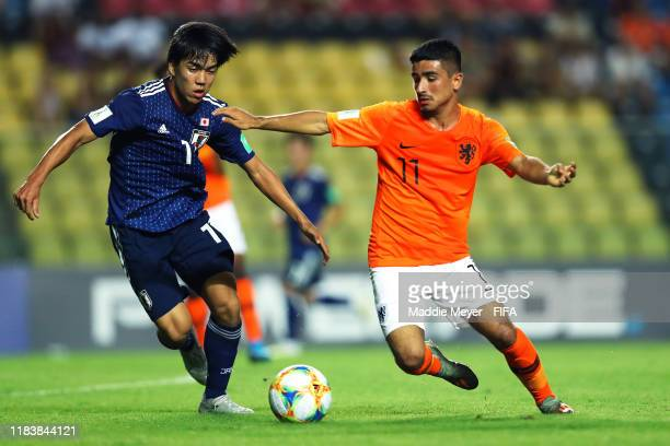 Satoshi Tanaka of Japan defends Naci Unuvar of Netherlands during the Group D Match between Japan and Netherlands in the FIF U-17 World Cup Brazil...