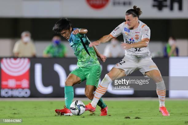 Satoshi TANAKA of Shonan Bellmare and BENJAMIN KOLOLLI of Shimizu S-Pulse battle for the ball during the J.League Meiji Yasuda J1 match between...