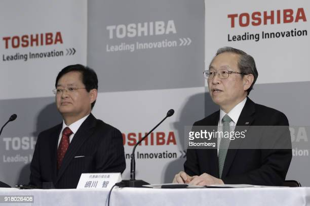 Satoshi Tsunakawa outgoing chief executive officer of Toshiba Corp right speaks while Nobuaki Kurumatani incoming chief executive officer and...