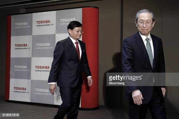 Satoshi Tsunakawa outgoing chief executive officer of Toshiba Corp right and Nobuaki Kurumatani incoming chief executive officer and chairman leave a...